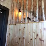 The renovated restaurant features a woodsy touch, but is a big change from the formerly dark pla