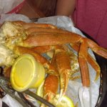 Crab legs and plastic souffle cup of not real butter
