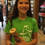 "My daughter with her ""Yooper pager"" (a piece of birch with a number on it!)"