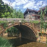 Ancient bridge which is 400+ years old. Stones that paved the bridge were worn smooth and slippe