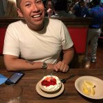 Me having a complementary Strawberry shortcake for birthday desert