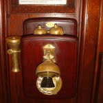 ... with an 'ancient' rotary dial phone on the wall ...