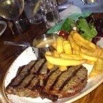 Medium-rare Rib-eye Steak with, chips, salad and Peppercorn Sauce