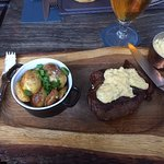 Ribeye steak covered in bearnaise sauce