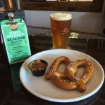 Warm pretzel with stone ground mustard and the Farm'rd Session IPA