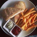 Mozarella and tomato panini with fries
