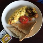 Cheese omelette with fried potatoes, roast toamto and toast