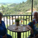 Lunch guests enjoy sparkling wine and a Bellini along with a view of Napa Valley.