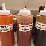 A few of the sauces available ala carte. All are labeled with gluten content.