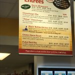 One of the menu boards showing the reasonable prices for each serving size.