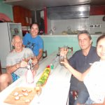 With the owners sharing a glass of wine at Pueblito Playa
