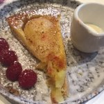 Warm pear tart - Poached pear on a base of almond frangipane on shortcrust pastry.