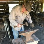Despite the warm temperatures, Danny the Blacksmith was working hard.