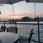 Sunset with a passing sailboat viewed from our outdoor seats!