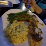Broiled stuffed shrimp with green beans and rice. A baked potato was ordered, but rice was deliv