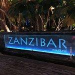 Zanzibar sign, from sidewalk at night
