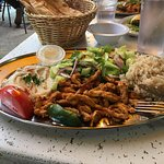 Chicken Shawarma platter with hummus, rice, and salad.