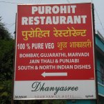 Board showing direction of Purohit Restaurant