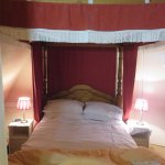 Four poster bed in upstairs suite - very cosy