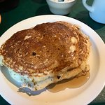 Short stack (2x pancakes) are more than enough.  The regular hot cakes order is 3x, and unless y