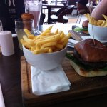 burger n chips £8 where is the mini gem lettuce, tomato and colslaw advertised on menu?