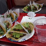 Tacos adobada on the left side, tacos asada on the right. 6 for each of us 4 friends.