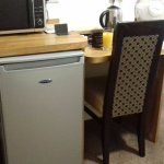 Fridge and microwave plus the only chair in the room