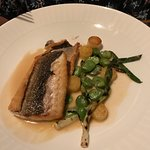 Branzino (fish) with confit potato, fava bean and spring onion