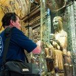 Touching the globe of the treasured Black Madonna at Montserrat