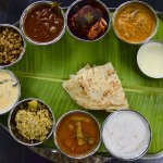 A mix of Indian dishes/Catamaran set on a banana leaf.