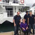My husband and I with Captain Jason and his wife Virginia - ramp accessibility = A+
