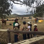 Kids getting a chat from one of the stockmen