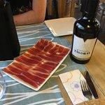 The Iberian Black Pig with the bottle of Tavoras Vinegar