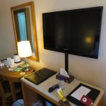 flat screen TV, work desk, kettle and hot drink amenities