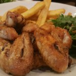 This is the TAVUK KANAT slow grilled free range Chicken Wings with Salad and Chips