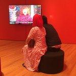 Visitor in Kusama wig viewing Kusama video