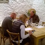 Studying the tasting notes at Pooley's Winery.