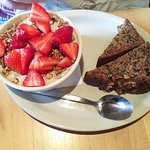Local yogurt with granola and strawberries. Banana bread.
