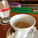 Very well made Italian espresso, served with a complementary cracker and water.