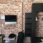 Basic closet (iron, ironing board), shelves, TV