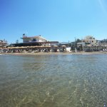 Robin beach and restaurant from the sea with underwater camera