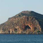 This is Theodorou (Protected Island with rare Kri Kri goats) visible from the taverna