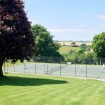 Enjoy a game of tennis on our championship size tennis court with complimentary rackets and ball