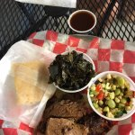 sliced brisket plate with collards and succotash