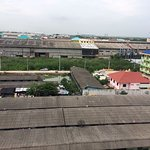 Open my balcony at 5th Floor, and voila, suvarnabhumi airport at horizon, and bad stench below.