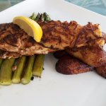 Sweet potato crusted salmon with asparagus and plantains.