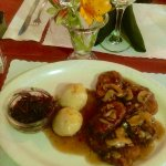 Jaeger Schnitzel Pork with potato dumplings clear mushroom gravy and sweet red cabbage