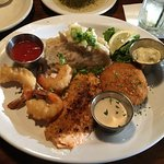 fries shrimp, onion encrusted salmon and crab cake dinner
