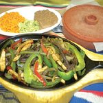 Beef fajitas platter. Served with warm tortillas and sides