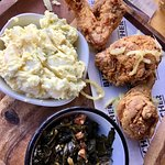 The Fried Chicken Plate, complete with potato salad and collar greens. 2 die 4!